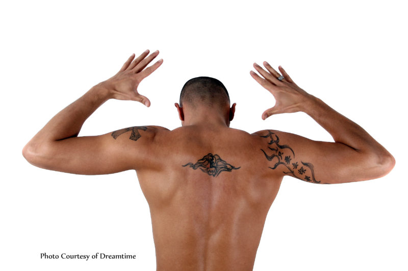 A Young man with a tattoos on his back